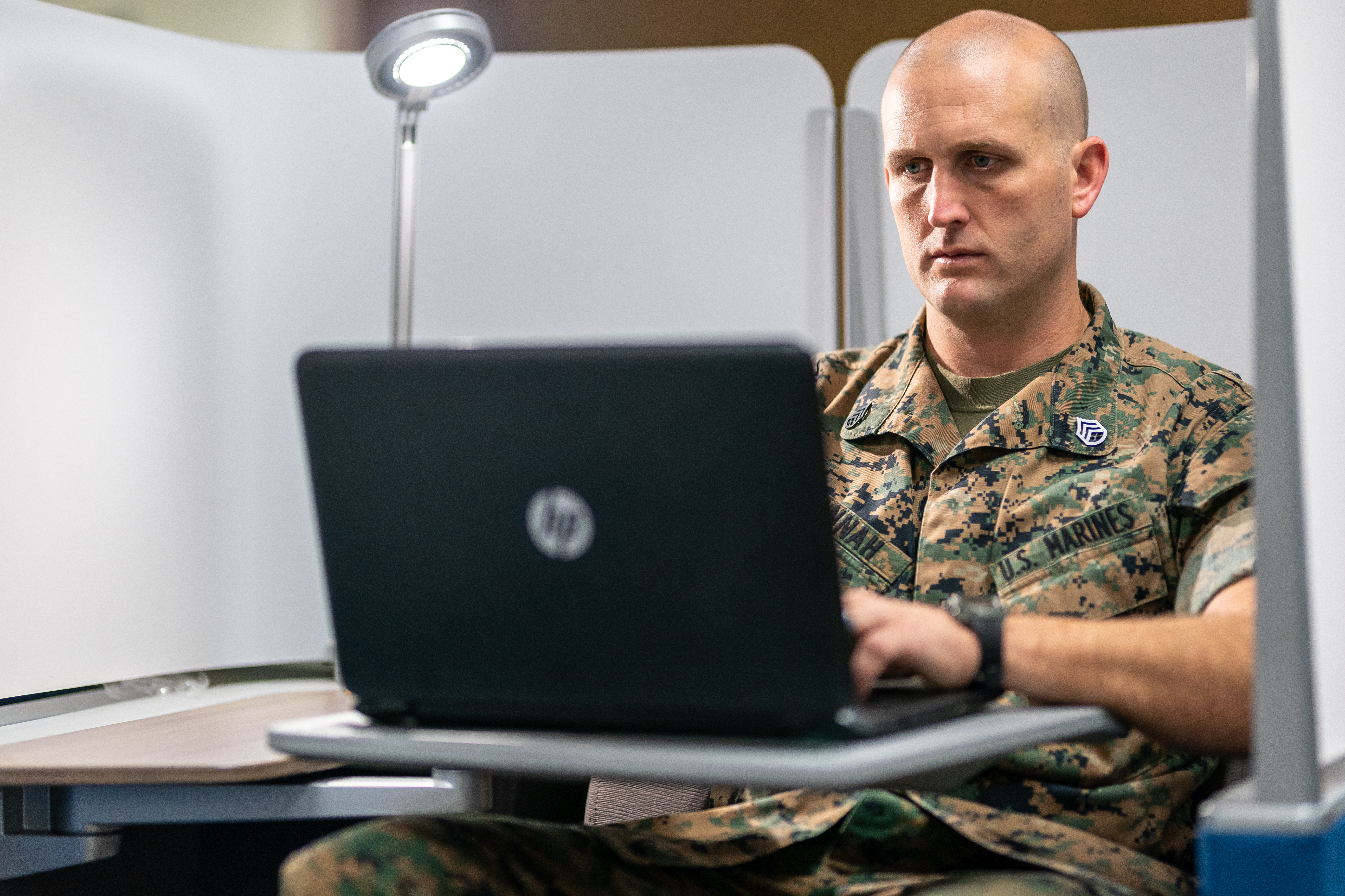 Servicemen studying with a laptop