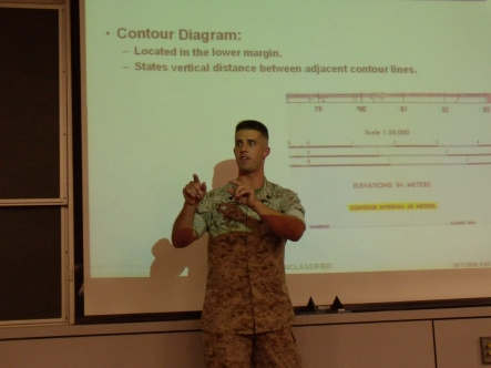 A MECEP teaching Land Navigation to Marine Contingent Cadets