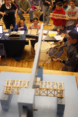 Students constructed bridges made of craft sticks and wood glue for the eWeek Bridge Building Competition.